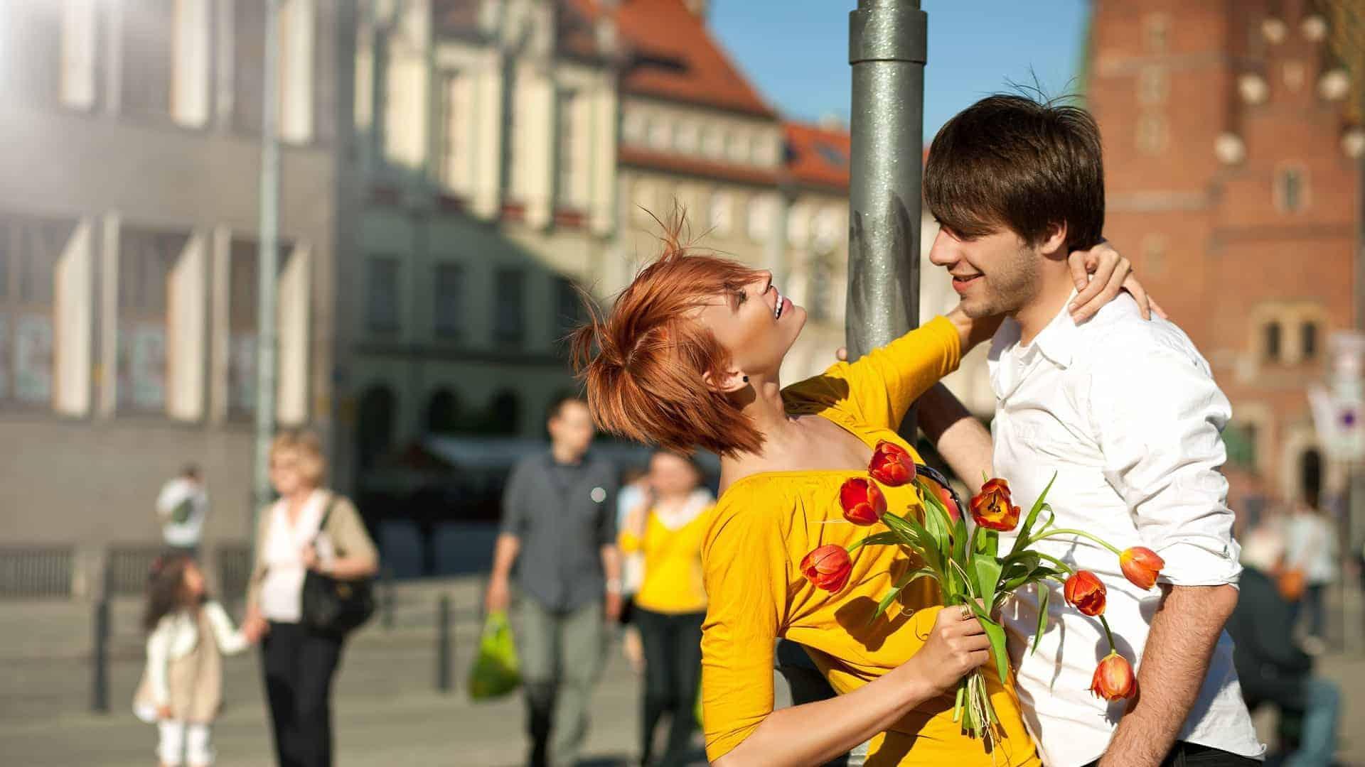 girl dating flowers hugs